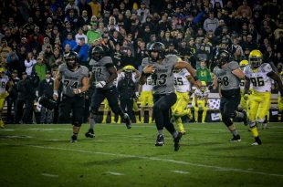 Junior quarterback Sefo Liufau rushes the ball into the end zone for his first rushing touchdown of the season during the Buffs' 41-24 loss to the Oregon Ducks at Folsom Field on Saturday, Sept. 4, 2015. (Robert Hylton/CU Independent)