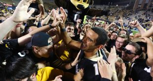 Sefo Liufau unites mid-field with CU fans celebrating the win against ASU 40-16. Oct. 15, 2016. (Will McKay/ CU Independent)