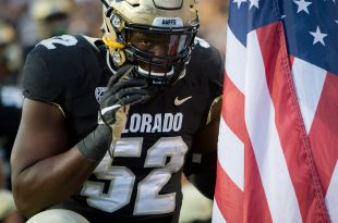 Junior defensive lineman, Leo Jackson III, says a quick prayer before kickoff during the Buffs' 40-16 win against the Arizona Sun Devils. Oct. 15, 2016. (Benjamin Chang/ CU Independent)