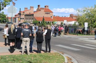 """Employees and students are evacuated out of the University Memorial Center on Wednesday, Oct. 6, 2016 due to an unconfirmed report of an """"active harmer."""" (Alexandra Greenwood/CU Independent)"""
