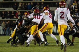 Jabari Ruffin, junior, of USC hits CU defenders on Folsom Field. Nov. 13, 2015. (Will McKay/CU Independent)