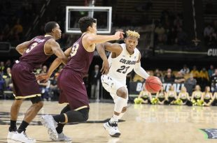 Freshman guard Bryce Peters looks to fight his way around two Warhawk defenders early in the first half of play at the Coors Events Center. Nov. 17, 2016 (Nigel Amstock/CU Independent)