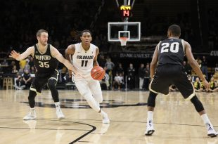 Senior Xavier Johnson takes the ball up court during the opening seconds of the Buffs 75-60 victory over the Wofford Terriers. Johnson recorded a double-double on the day with 27 points and 12 rebounds. Coors Events Center. Nov. 27, 2016 (Nigel Amstock/CU Independent)
