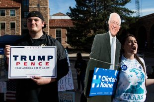 Screaming in support of Hillary, a volunteer holds a Bernie sign next to a Trump supporter. (Jackson Barnett/CU Independent)