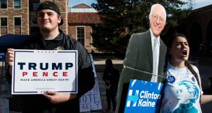 Screaming in support of Clinton, a volunteer holds a Bernie Sanders sign next to a Trump supporter on Election Day, Nov. 8. (Jackson Barnett/CU Independent File)