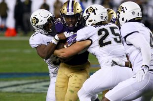 The Buff defense swarms a Washington rusher during the second quarter of play at Levi's Stadium. Washington is up 14-7 at the half. Dec. 2, 2016 (Nigel Amstock/CU Independent)