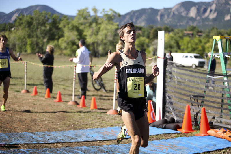 Blake Theroux (28), of CU, crosses the finish line, winning the men's 8K at the 2013 Rocky Mountain Shootout, Saturday, Sept. 28, 2013, at Buffalo Ranch Cross Country Course in Boulder, Colo. The 3rd-ranked CU men's cross country team took first overall in the meet. (Kai Casey/CU Independent)