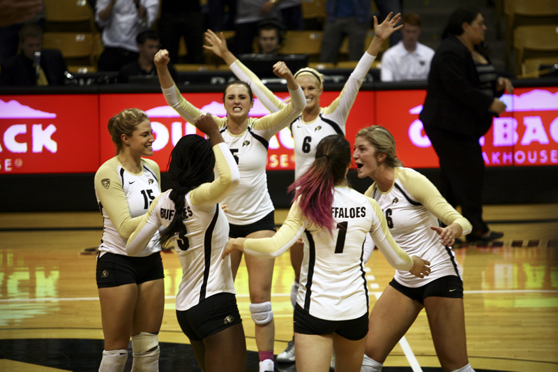 Members of the CU Volleyball Team celebrate after winning the second set of their Oct. 4th match against top-ranked Washington. The Buffs won the match three games to one. (James Bradbury/CU Independent)