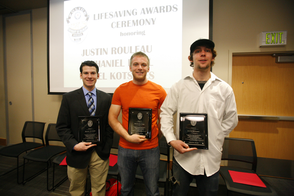 From left, Daniel Kotsides, a community safety officer, Nathaniel Pohl, a residential advisor, and Justin Rouleau, a cook in the C4C, pose for a photo at after receiving their Lifesaving Awards. The three students received the award for saving an 80-year-old man's life, using the Heimlich manuever, CPR and a defribrillator. (Kai Casey/CU Independent)