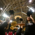CU cheerleaders pump up the crowd before the start of the game. (Kai Casey/CU Independent)