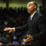 Harvard head coach Tommy Amaker talks to one of his players. (Kai Casey/CU Independent)