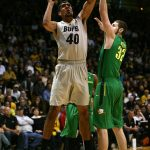 Colorado sophomore forward Josh Scott (40) protects the ball while going up for a jump shot against Oregon's Ben Carter (32). (Kai Casey/CU Independent)