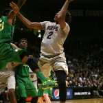 Colorado sophomore forward Xavier Johnson (2) shoots with one hand while falling away from the basket. (Kai Casey/CU Independent)