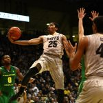 Colorado junior guard Spencer Dinwiddie (25) flies for a layup as Colorado's Johs Scott (40) and Oregon's Mike Moser (0) watch. (Kai Casey/CU Independent)