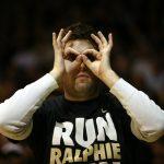 "A Colorado fan wears ""3 goggles"" while celebrating a Colorado 3-pointer. (Kai Casey/CU Independent)"