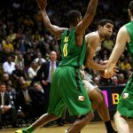 Colorado sophomore forward Josh Scott (40) looks to pass as he drives into the lane against Oregon's Mike Moser (0). (Kai Casey/CU Independent)