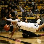 Colorado's Jamee Swan (50) and Arizona State's Promise Amukamara (10) dive for a loose ball before it goes out-of-bounds. (Kai Casey/CU Independent)