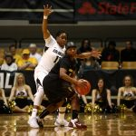 Colorado senior guard Brittany Wilson (11) plays tight defense on Arizona State's Elisha Davis (23). (Kai Casey/CU Independent)