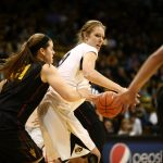 Colorado senior center Rachel Hargis (40) backs into Arizona State's Sophie Brunner (21) as she nears the hoop. (Kai Casey/CU Independent)