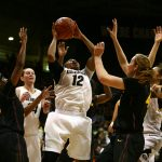 Colorado senior guard Ashley Wilson (12) grimaces as she goes back up for a layup after getting an offensive rebound. (Kai Casey/CU Independent)