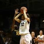 Colorado sophomore forward Arielle Roberson (32) shoots over Arizona State's Promise Amukamara (10) from near the hoop. (Kai Casey/CU Independent)
