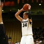 Colorado junior forward Jen Reese (34) shoots a mid-range jumper past the reach of Arizona State's Kelsey Moos (24). (Kai Casey/CU Independent)