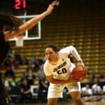 Colorado sophomore forward Jamee Swan (50) stares down Arizona State's Joy Burke (3) before making a move toward the hoop. (Kai Casey/CU Independent)