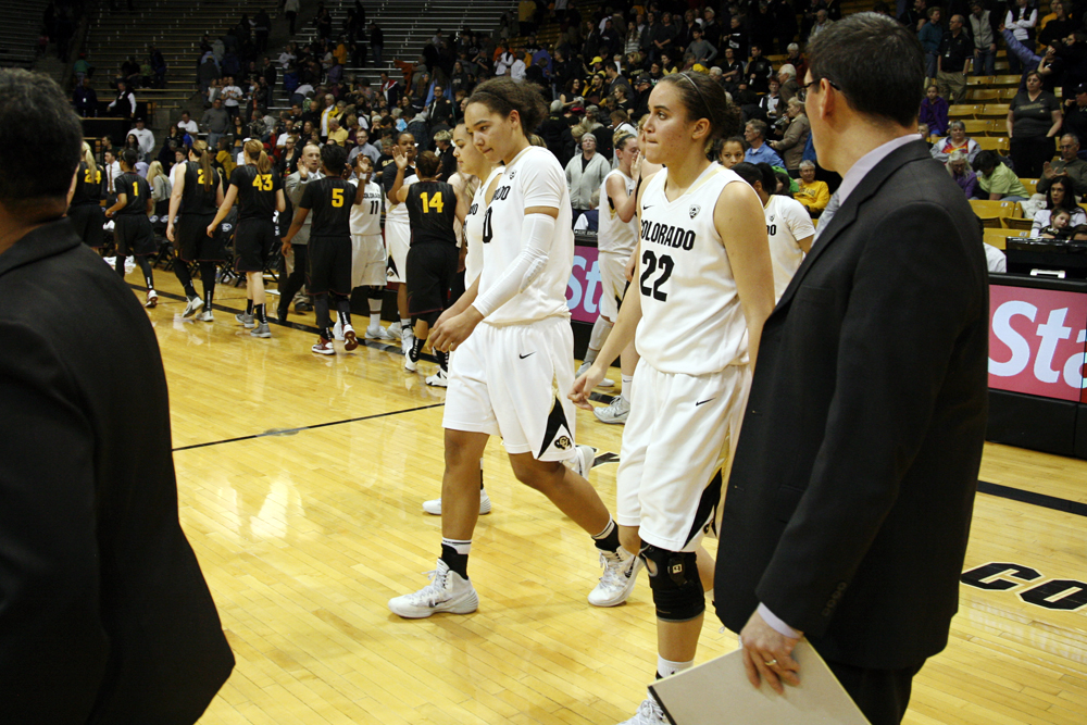 Jamee Swan (50), left, and Haley Smith (22) walk dejectedly towards half-court after losing to No. 14 Arizona State in the last minute, Sunday at the Coors Events Center in Boulder, Colo. (Kai Casey/CU Independent)