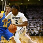 Sophomore forward Xavier Johnson (2) drives hard against UCLA's David Wear (12). (Nigel Amstock/CU Independent)