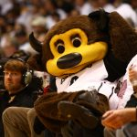 "CU Mascot ""Chip"" poses for a photo atop two fans in the front row. (Nigel Amstock/CU Independent)"