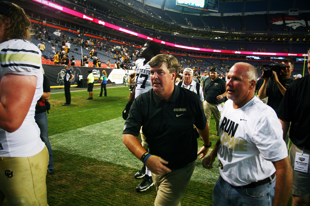 Colorado head coach Mike MacIntyre leaves the field following his first game, a 41-27 victory over in-state rival Colorado State on Sept. 1, 2013. (James Bradbury/CU Independent)