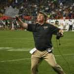 Coach Mike MacIntyre celebrates as the officials signal a turnover on downs giving the Buffs possession late in the fourth quarter of their 41-27 victory over Colorado State on Sept. 1, 2013. (James Bradbury/CU Independent)