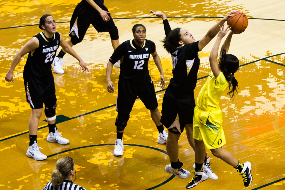 Colorado sophomore Jamee Swan (50) stuffs the shot of Oregon freshman Drea Toler (1) resulting in a Colorado possession. The Oregon Ducks play the Colorado Buffaloes at Matthew Knight Arena in Eugene, Ore. on Feb. 10, 2014. (Taylor Wilder/Emerald)
