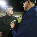 Colorado head coach Mike MacIntyre, left, shakes hands with Arizona head coach Rich Rodriguez after the Arizona WIldcats won 44-20 at Folsom Field, Saturday, Oct. 26, 2013. (Kai Casey/CU Independent)