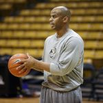 Jean Prioleau, Colorado associate head coach, helps his team run through drills during practice. (Kai Casey/CU Independent)