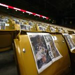 The front page of the game day edition of the Colorado Daily sits on every seat in the first 15 rows of the east side of the Coors Events Center for students to use during the College GameDay broadcast. (Kai Casey/CU Independent)
