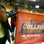 ESPN College GameDay crew set up a banner on the court at the Coors Events Center. (Kai Casey/CU Independent)