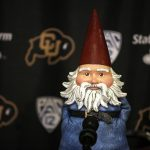 The Travelocity Gnome fields questions during a mock press conference for the ESPN College GameDay broadcast at the Coors Events Center, Saturday, Feb. 22, 2014, in Boulder, Colo. (Kai Casey/CU Independent)