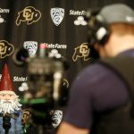 A ESPN cameraman shoots video of the Travelocity Gnome during a mock press conference for the ESPN College GameDay broadcast at the Coors Events Center, Saturday, Feb. 22, 2014, in Boulder, Colo. (Kai Casey/CU Independent)