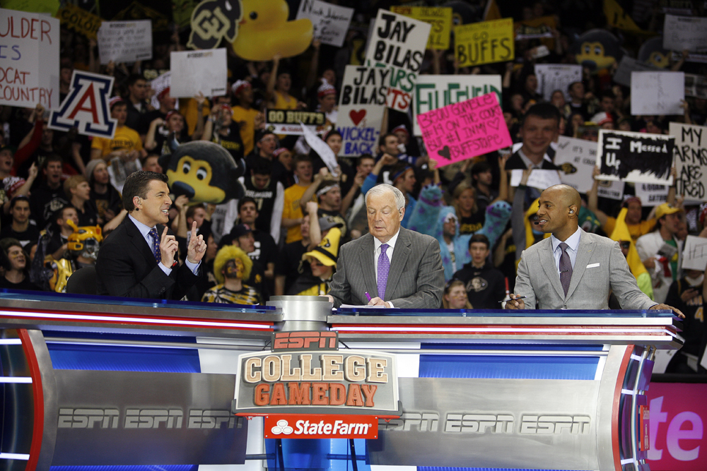 From left to right, Rece Davis, anchor of College GameDay, Digger Phelps and Jay Williams discuss various topics around the college basketball world during the ESPN College GameDay broadcast at the Coors Events Center on Saturday in Boulder, Colo. (Kai Casey/CU Independent)