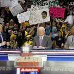 Colorado fans hold up creative signs in support of their Buffs behind Rece Davis, Digger Phelps and Jay Williams during the ESPN College GameDay broadcast at the Coors Events Center, Saturday, Feb. 22, 2014, in Boulder, Colo. (Kai Casey/CU Independent)