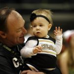 Colorado athletic director Rick George plays with his granddaughter Harper during the ESPN College GameDay broadcast at the Coors Events Center, Saturday, Feb. 22, 2014, in Boulder, Colo. (Kai Casey/CU Independent)