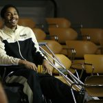 """Colorado junior guard Spencer Dinwiddie smiles as the crowd chants """"one more year"""" during the ESPN College GameDay broadcast at the Coors Events Center, Saturday, Feb. 22, 2014, in Boulder, Colo. Dinwiddie tore his ACL against Washington on Jan. 12 and is out for the year. (Kai Casey/CU Independent)"""