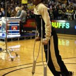 Colorado junior guard Spencer Dinwiddie walks off the court on crutches after on interview on the ESPN College GameDay broadcast at the Coors Events Center, Saturday, Feb. 22, 2014, in Boulder, Colo. Dinwiddie tore his ACL against Washington back in January and is out for the year. (Kai Casey/CU Independent)