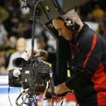 David Barnes adjusts his camera on the end of a jimmy jib during the ESPN College GameDay broadcast at the Coors Events Center, Saturday, Feb. 22, 2014, in Boulder, Colo. (Kai Casey/CU Independent)