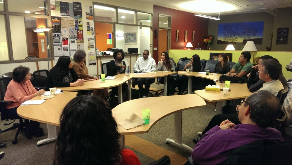 Quengail Ameyaw tells a group of about 19 people gathered in the Center for Community's Center for Mauticultural Affairs ofice details of her what she has perceived to be a racially adverse campus climate. (Alison Noon/CU Independent)