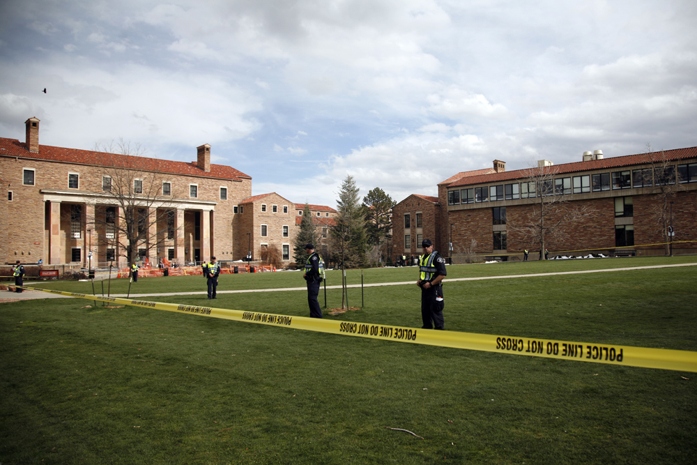Police officers stand guard on an empty Norlin Quad at 4:22 p.m., April 20, 2013, in Boulder, Colo. (Kai Casey/CU Independent File)