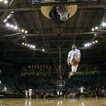 Junior guard, Askia Booker, goes up for a between the legs dunk during warm ups before tip off against Arizona State on Wednesday, Feb. 19, 2014. Booker had 18 points in the Buffs 62-51 victory. (Matt Sisneros/CU Independent)