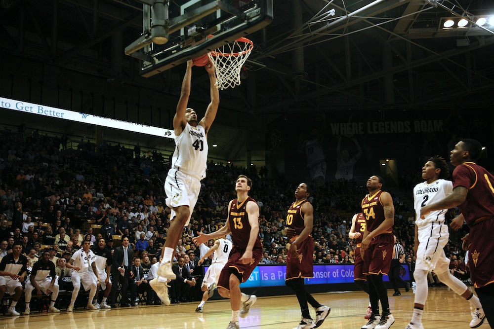 Center Josh Scott dunks the ball over the Arizona St. defense. (Matt Sisneros/CU Independent)