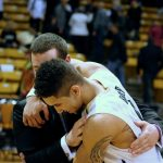 Junior guard, Askia Booker, hugs an assistant coach, celebrating his 18 point performance in the Buffs 62-51 victory over the Arizona State Sun Devils on Feb 19, 2014. (Matt Sisneros/CU Independent)